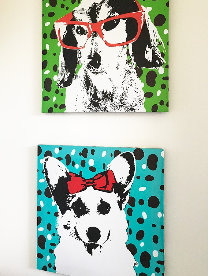 paintings of two dogs in second bedroom at the dog house port macquarie