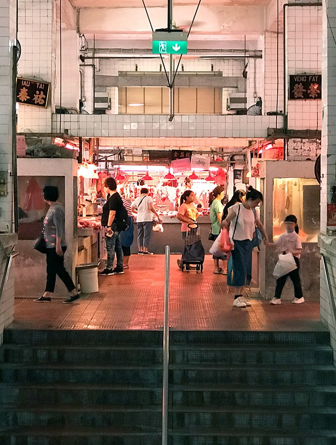 people walking around level three of the red market macao