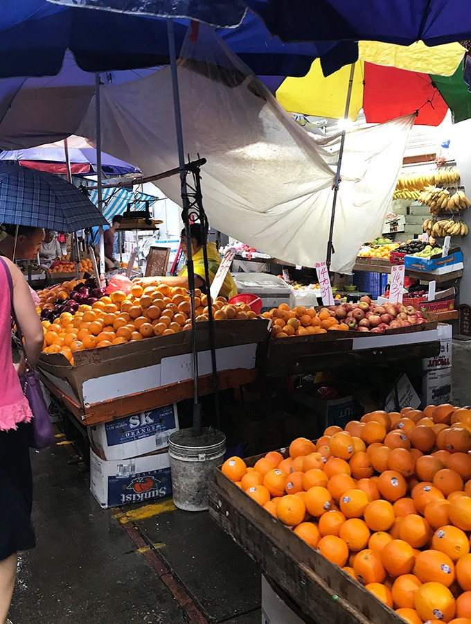 oranges being sold at the outside market at the red market macao