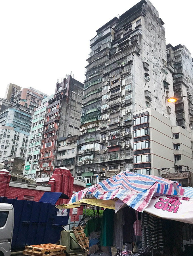 tall grey residential buildings overlooking the red market macao