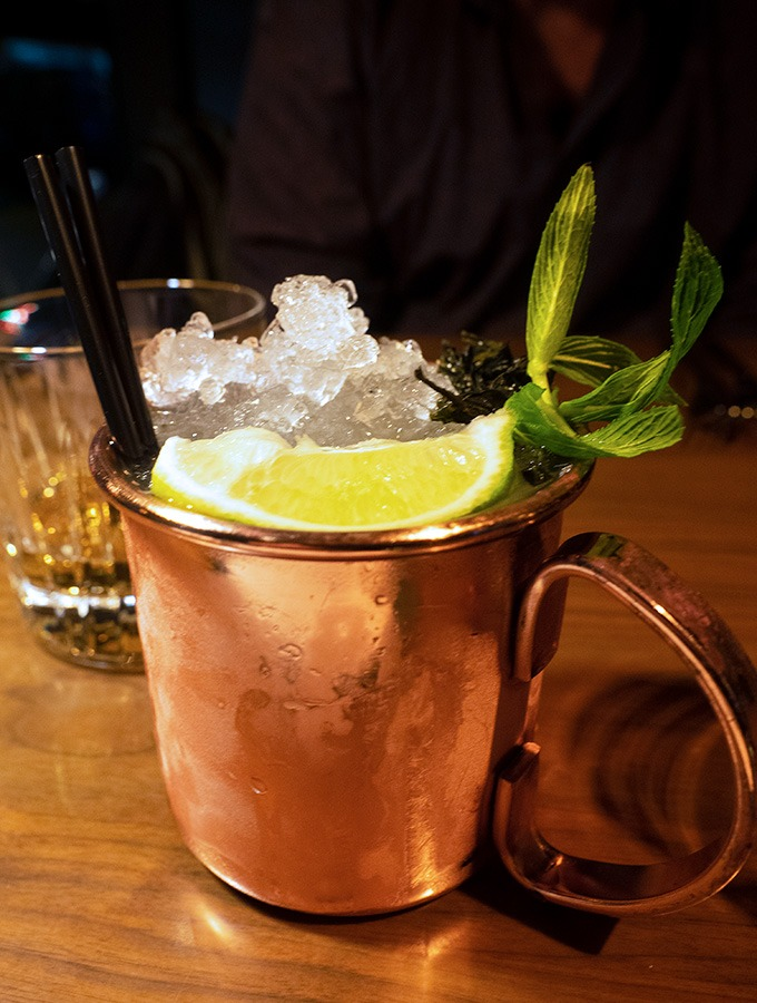 copper tankard with crushed ice, slice of lime and mint