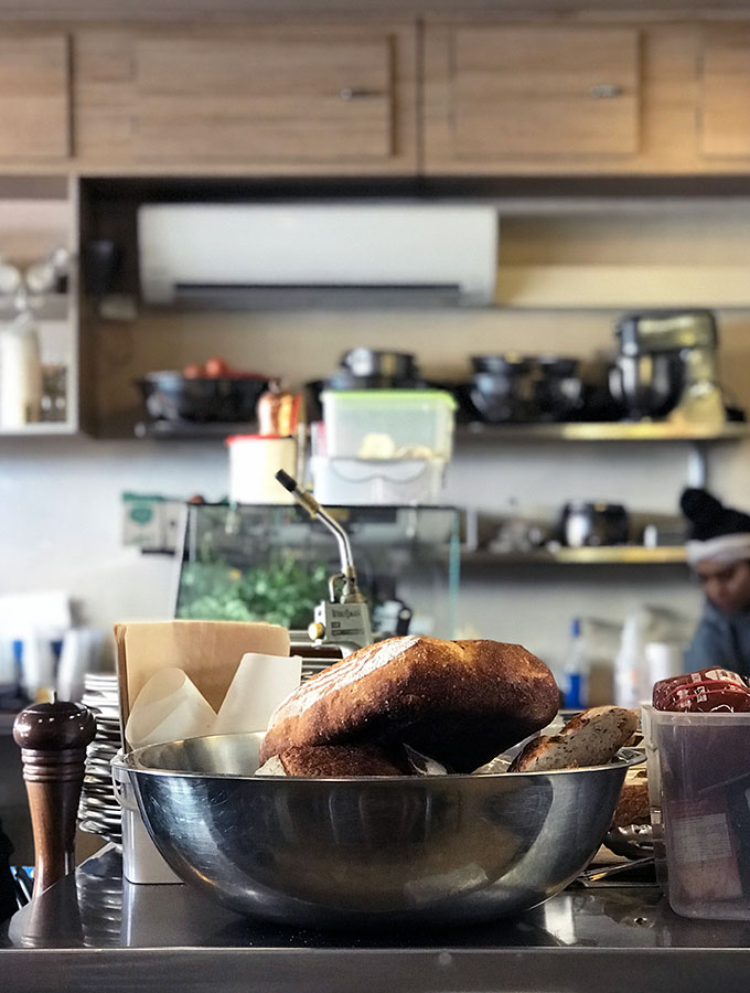 sourdough in a metal bowl on a counter