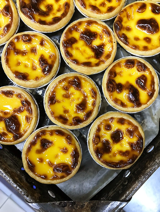tray of macanese egg tarts straight from the oven