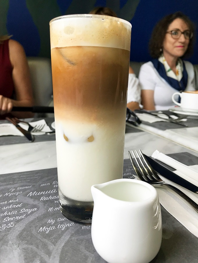 iced coffee in a glass showing the three layers of the drink