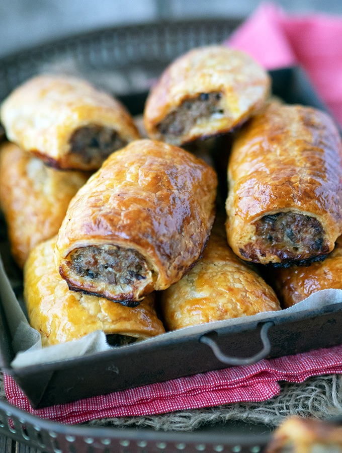 sausage rolls in a metal tray