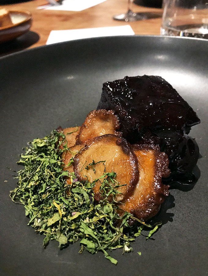 wagyu topside with mushrooms and dried kale on a plate at bangalay dining