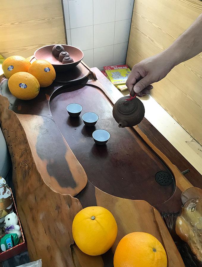 Long Va Tea House in Macao - an antique tea pouring table