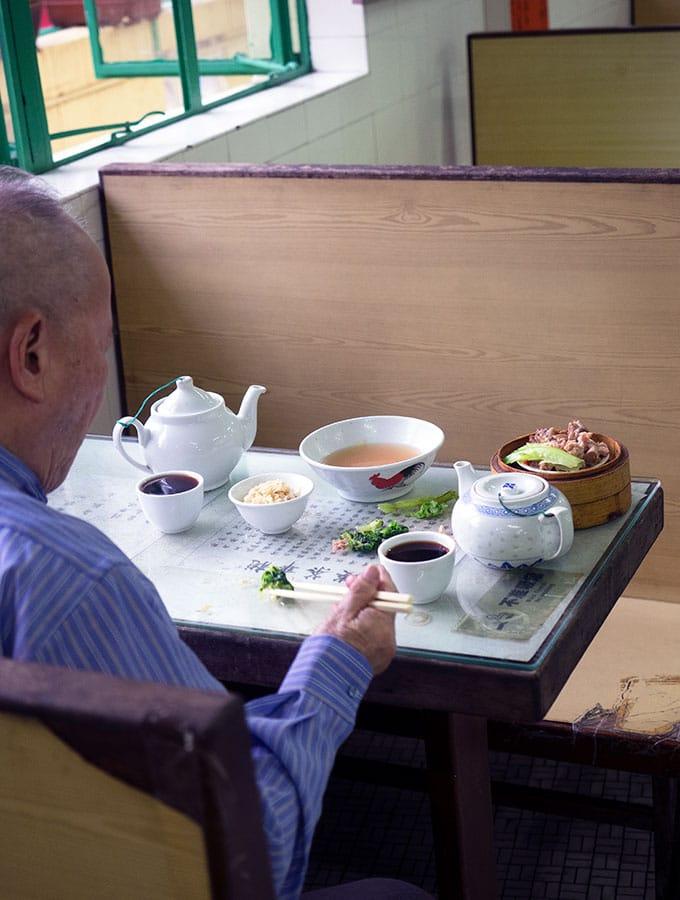 Long Va Tea House in Macao - man having tea and dim sum