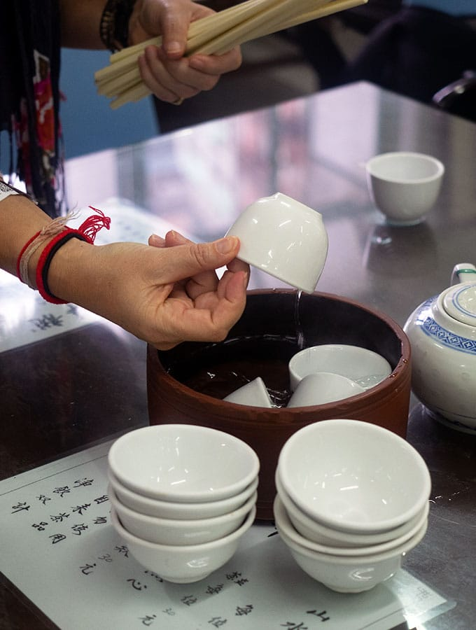 Long Va Tea House in Macao - washing tea cups ready for use