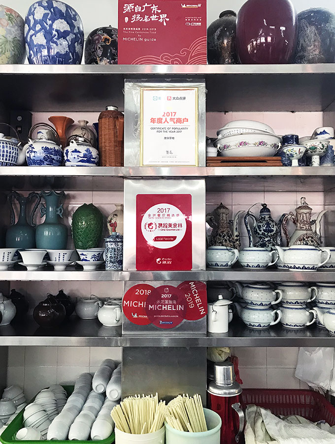 Long Va Tea House in Macao - a selection of tea cups and pots on shelves