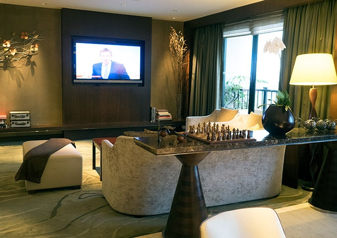 seats and television in the club lounge