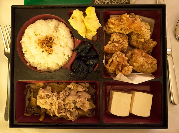 bento box with chicken rice and tofu