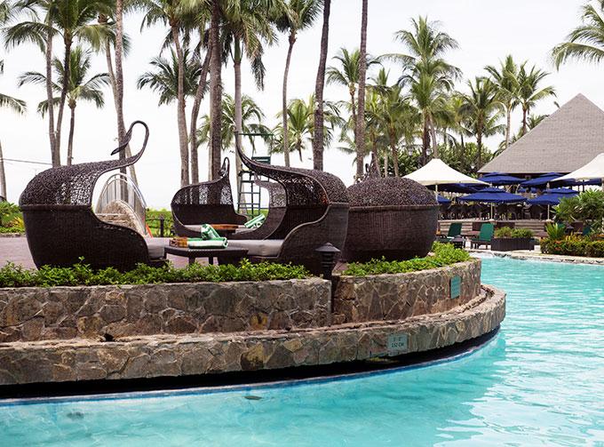 seating by the pool at Sofitel Philippine Plaza Manila