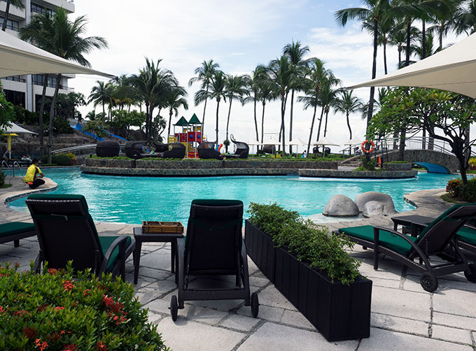loungers by the pool at Sofitel Philippine Plaza Manila