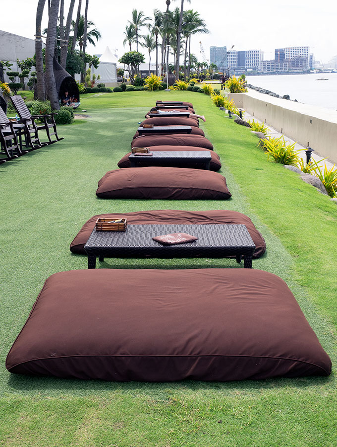 giant pillows on grass with tables at Sofitel Philippine Plaza Manila