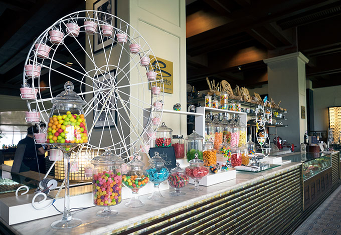 candy bar with various candy and a ferris wheel