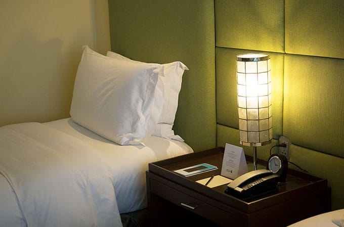 single bed with side table and lamp