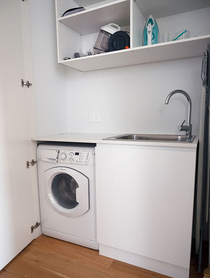 washing machine and sink in the laundry cupboard