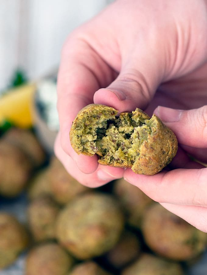 baked falafel being broken to show soft moist centre