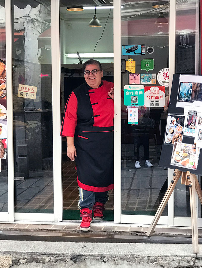 Chef Anna Manhao standing in the door to her restaurant