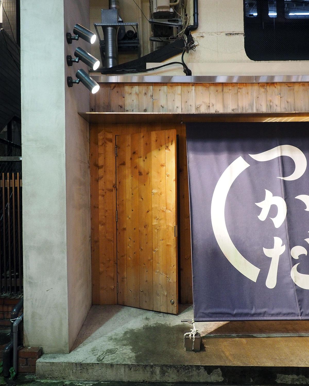 wooden door leading to the secret sake speakeasy