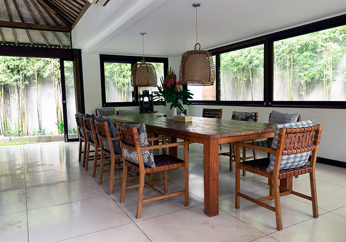 wooden table and chairs in dining area