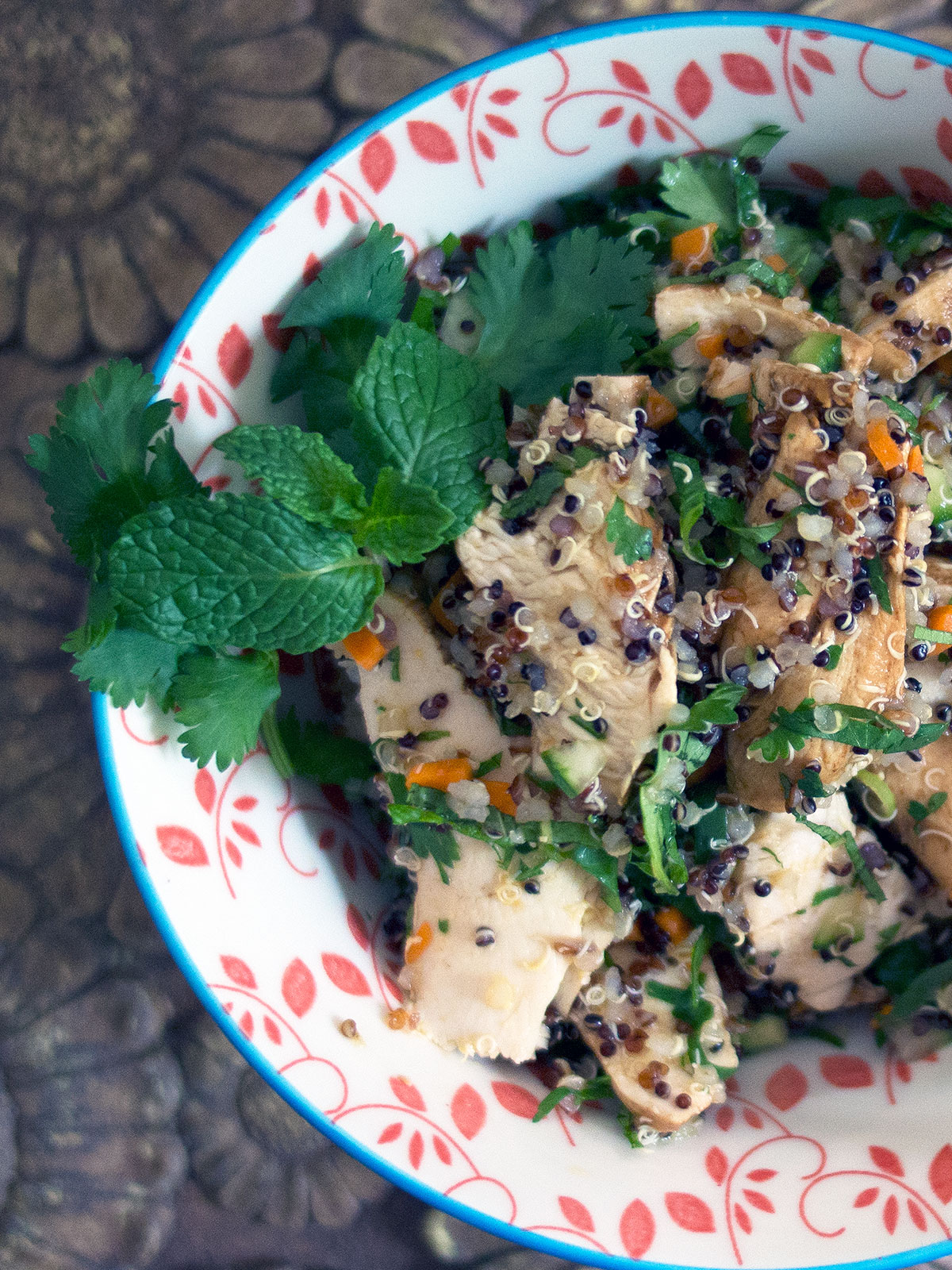 salad of chicken quinoa fresh herbs in a serving dish