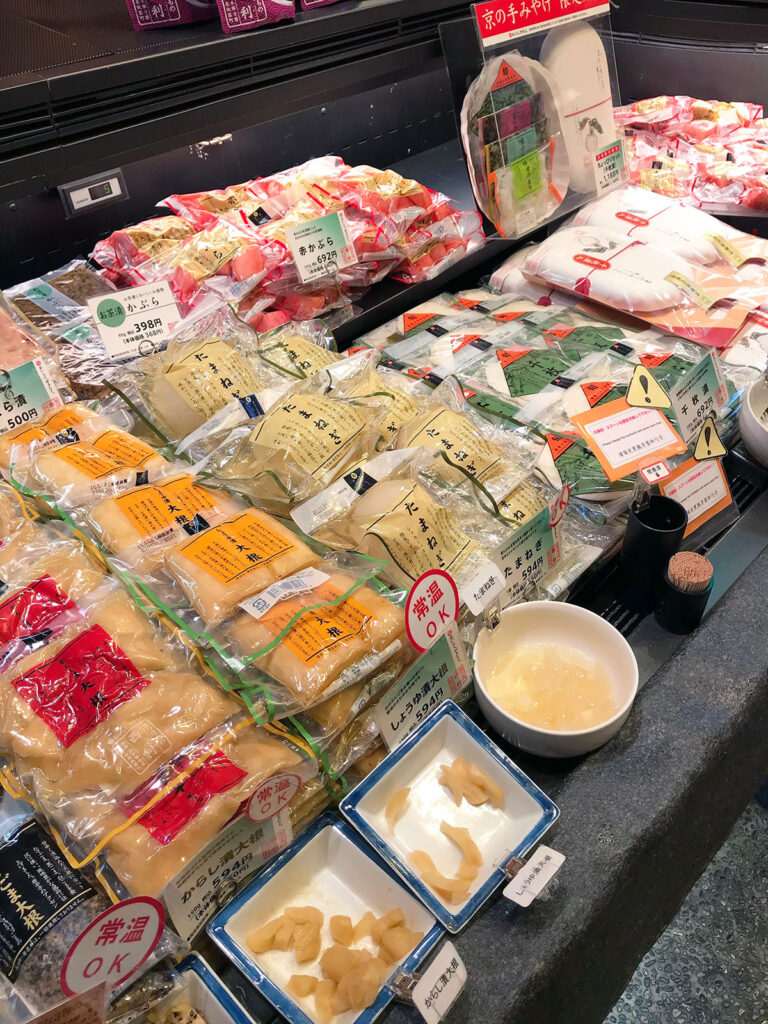 various pickled daikon products individually wrapped for sale at nishiki markets