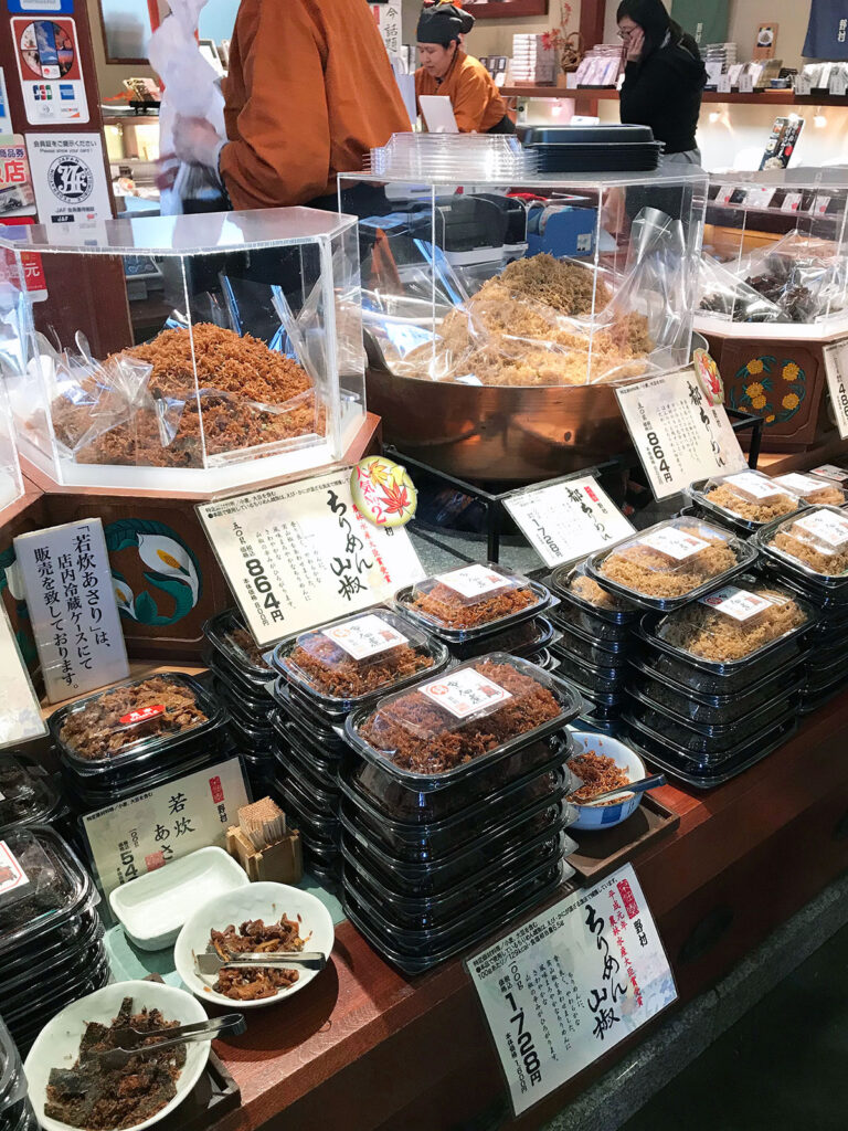 marinated tiny fish in containers ready to buy at nishiki markets