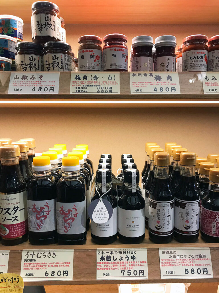 various jars and bottled of soy sauce and pastes on a shop's shelves