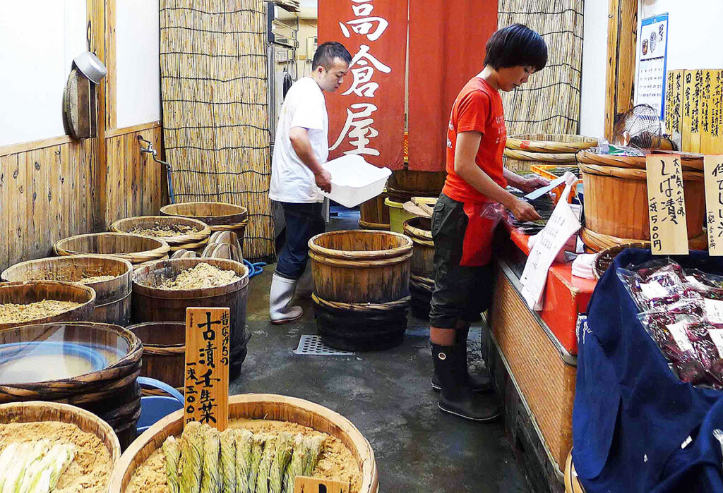 people preparing pickles in their shop