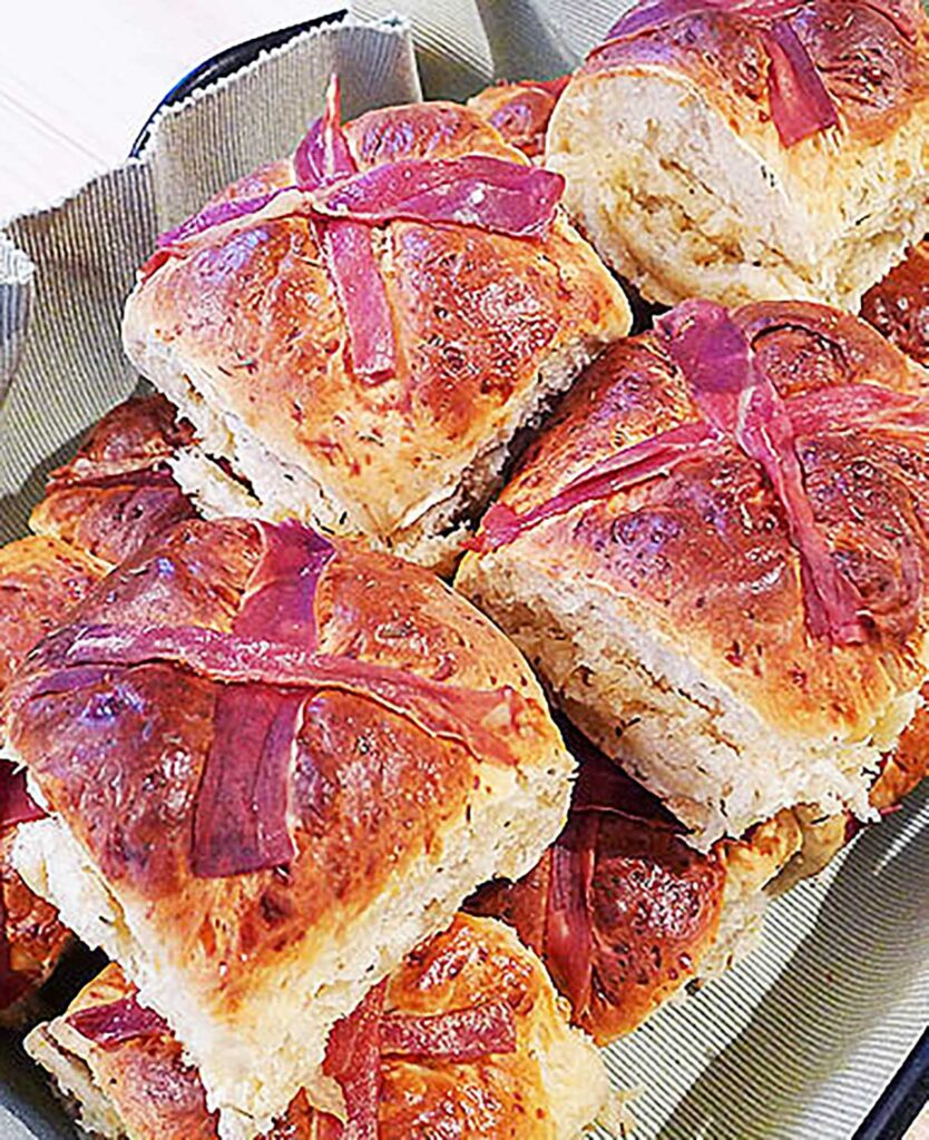 savoury easter buns, hot cross buns with prosciutto crosses in a bowl