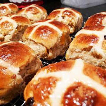hot cross buns, apricot and fig cooling on a wire cake rack