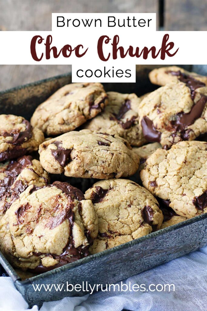 chocolate chunk cookies piled up in an embossed baking tray
