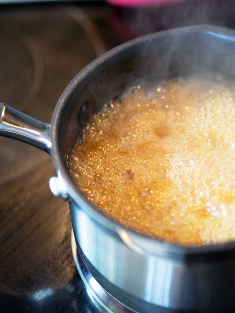 butter, sugar and wine bubbling away in a saucepan