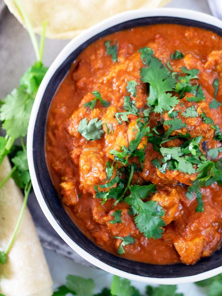 Chicken Karahi in a bowl topped with fresh coriander