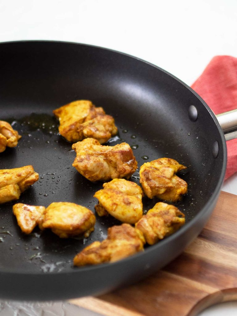 browning chicken in a fry pan