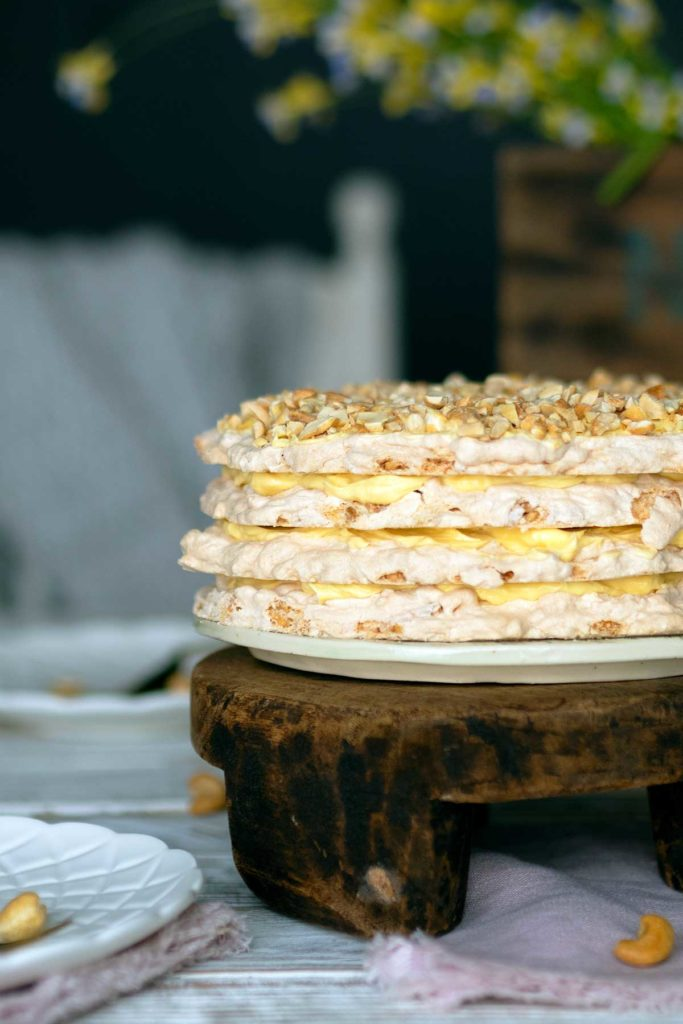 sans rival cake on a wooden stand