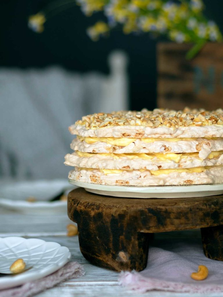 close up of sans rival cake on a wooden stand