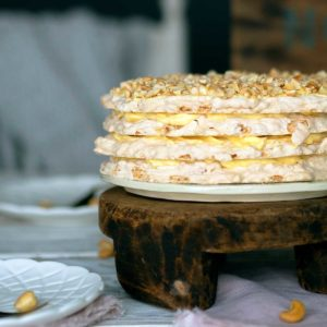 sans rival filippino cashew meringue cake on a wooden stand