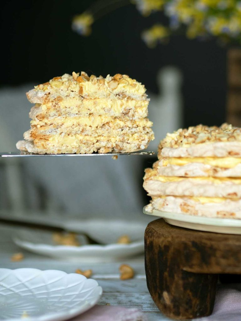 slice of sans rival being removed from the cake