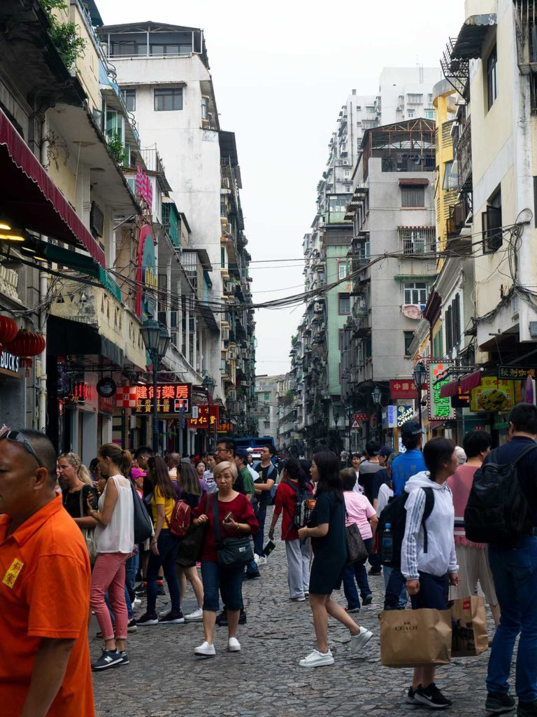 tourists walking along rue de sao paulo in macao