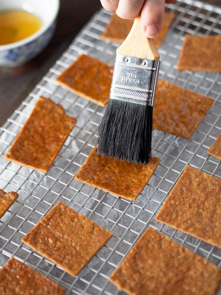 brushing rougan with honey glaze