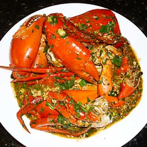 finished dish of chilli mud crab in a white bowl