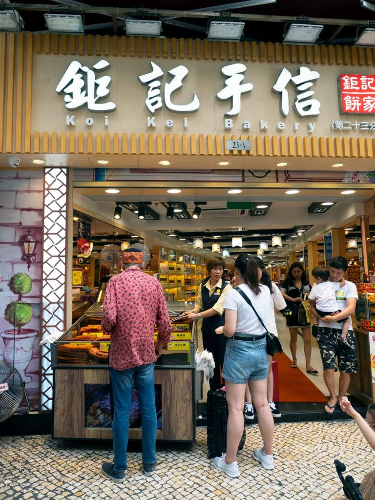 koi kei bakery in macao people standing out front tasting bak kwa samples
