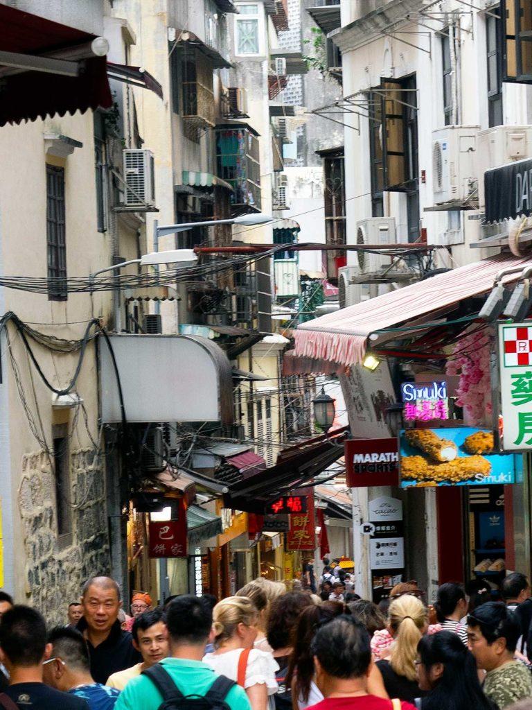 mass of tourists walking rue de sao paulo in macau