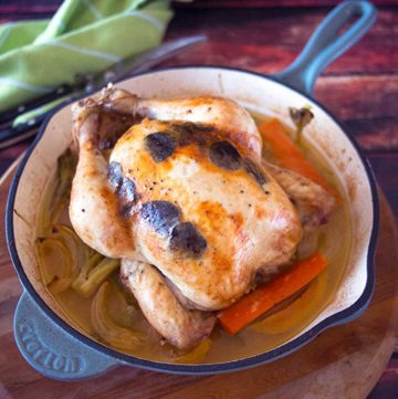 Roasted chicken in an iron pan.
