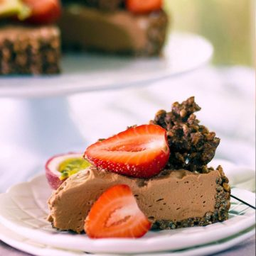 A slice of chocolate cheesecake pie topped with fresh strawberry.