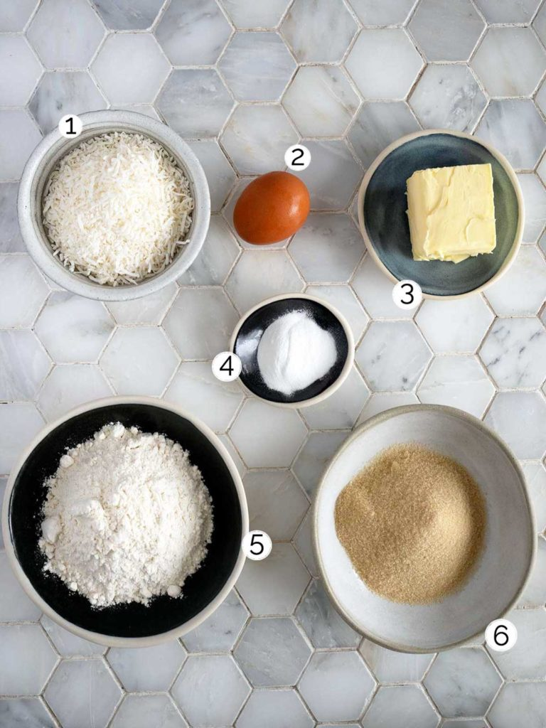 coconut biscuit ingredients laid out on white tiles