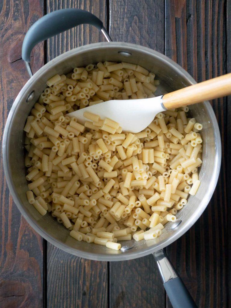 vinegar being mixed through macaroni